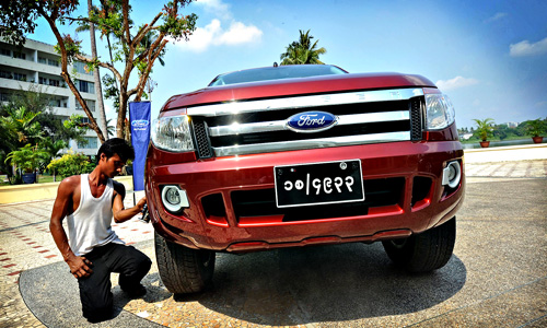 A worker polishes a Ford during an event...A worker polishes a Ford during an event by US carmaker Ford in Yangon on April 30, 2013. US carmaker Ford announced plans on April 30 to enter into the Myanmar market as sanctions have eased following democratic reforms in 2012. AFP PHOTO/ Soe Than WINSoe Than WIN/AFP/Getty Images